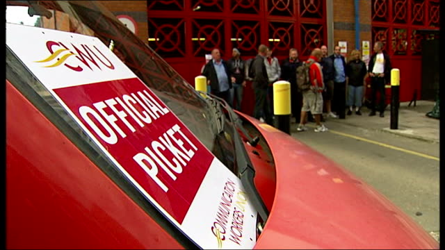 Dispute over pay may lead to strike action London Paul Tolhurst interview SOT EXT 'Official Picket' placard on van outside sorting office striking...