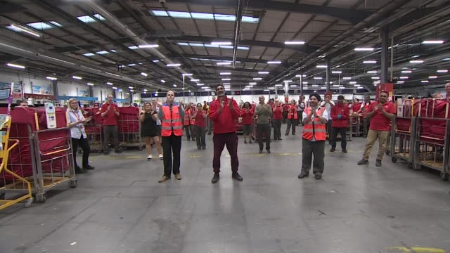 royal mail postal workers in nottingham applauding during the clap for carer event during coronavirus pandemic - answering stock videos & royalty-free footage