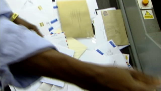 Royal Mail postal workers' strike second day ENGLAND INT Letters being sorted and along on conveyor