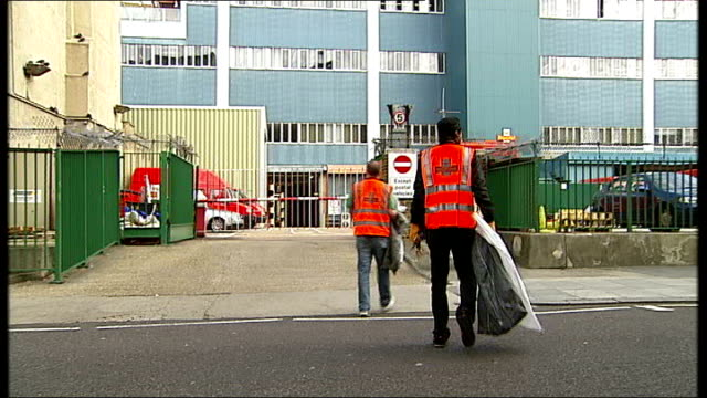 royal mail postal workers' strike: second day; london: rathbone place: two royal mail managers collecting post from post box london: striking postal... - ロイヤルメール点の映像素材/bロール