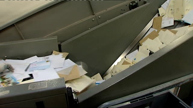 Royal Mail postal workers' strike second day Machine for sorting mail and letters sorted into piles