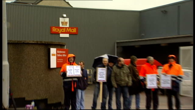Royal Mail postal workers' strike second day SCOTLAND Aberdeen Royal Mail sign PULL OUT postal workers on picket line PAN along CWU placards reading...