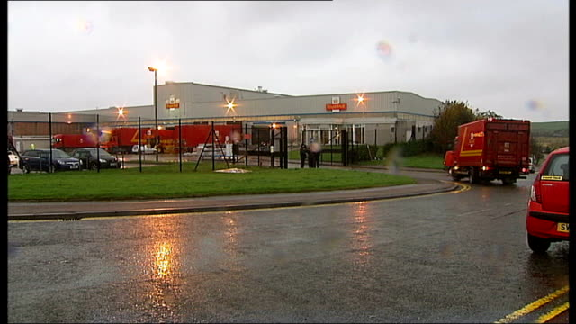 royal mail postal workers to hold more days of strikes; scotland: aberdeen: day postal van along into depot several striking postal workers outside... - ロイヤルメール点の映像素材/bロール