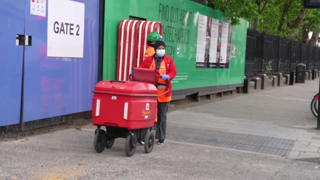 royal mail postman working in east london after the prime minister announced the general contours of a phased exit from the current lockdown, adopted... - ロイヤルメール点の映像素材/bロール