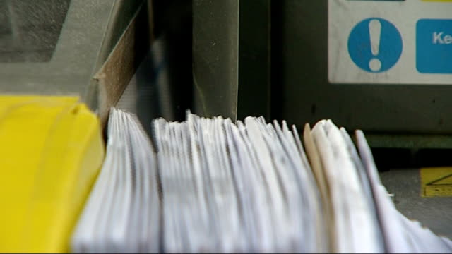 Royal Mail privatisation 'within weeks' says government R22100913 / Gatwick Letters being sorted Royal Mail worker putting mail in sorting machine...