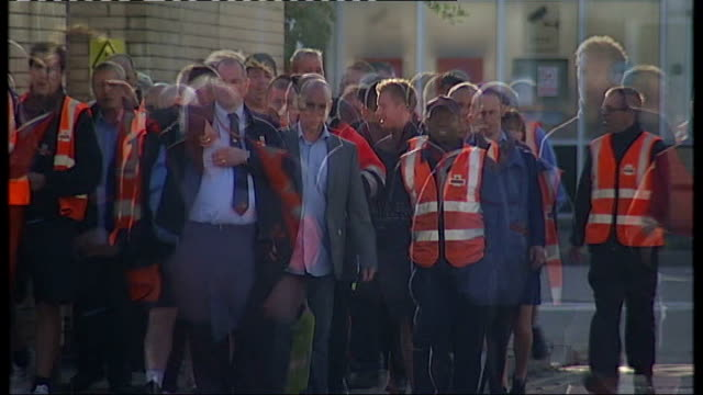 Royal Mail strike will go ahead EXT Royal Mail postal workers along outside depot gathered together to hear speaker voting with show of hands