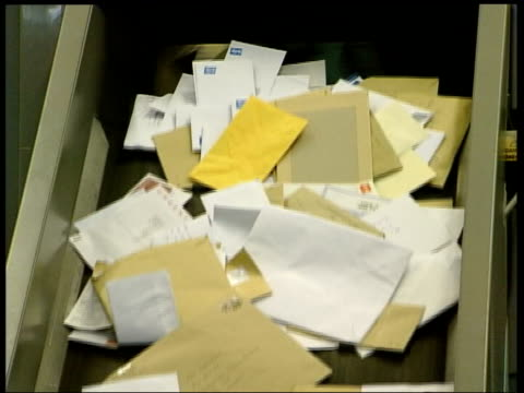 Royal Mail to announce profits of 200 million Missing letters R08100201/ITN London INT GVS post being sorted in a sorting office