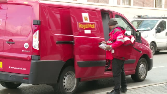 royal mail trial new fleet of electic tricycle delivery bikes england london stratford ext royal mail van along / various of postal worker postman... - bicycle stock videos & royalty-free footage
