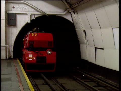 royal mail underground train (mail rail) arrives at platform - rail transportation stock videos & royalty-free footage