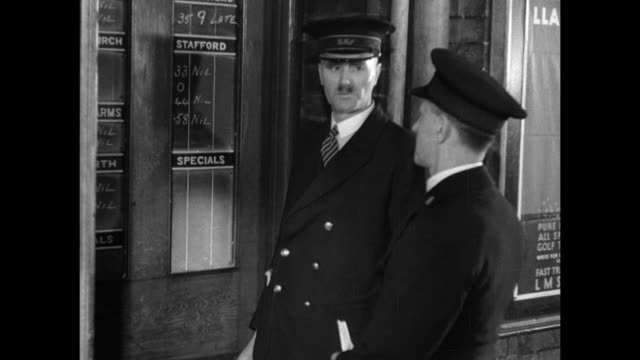 montage royal mail workers posting train delivery times and postal workers in the control room calling on the phone discussing train arrival times / united kingdom - postal worker stock videos & royalty-free footage