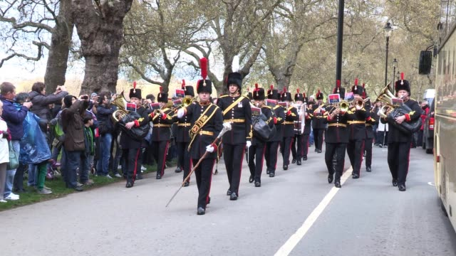 a royal marching band proceed by as the king's troop royal horse artillery mark the queen's 86th birthday queen elizabeth ii 86th birthday gun salute... - royal horse artillery stock videos and b-roll footage