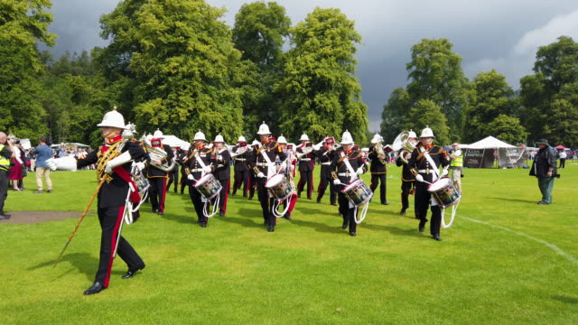 A Royal Marine band parades through the town at the start of the Highland Games on July 16 2019 in Inverarary Scotland The Games celebrate Scottish...