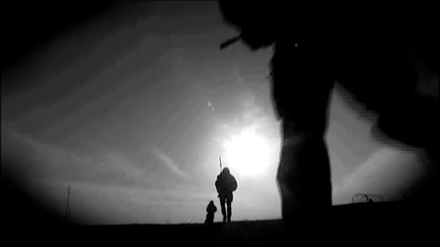 royal marine found guilty of murdering afghan prisoner graphicised sequence british troops on patrol in afghanistan silhouetted against sky - prisoner silhouette stock videos & royalty-free footage