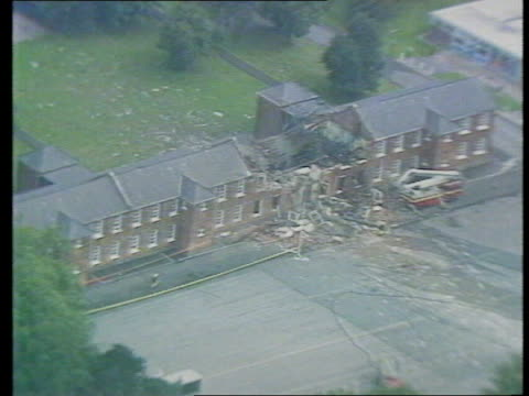 Security Royal Marines Barracks bomb blast Security ITN LIB London Mill Hill Inglis Barracks AIRV Inglis barracks with roof blown out and debris ZOOM...