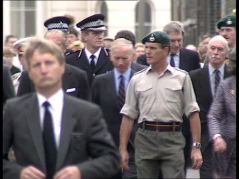 Duke of Edinburgh EXT MS Duke of Edinburgh Countess Mountbatten looking at wreaths MS Prince Philip walking along street with servicemen CMS Ditto MS...