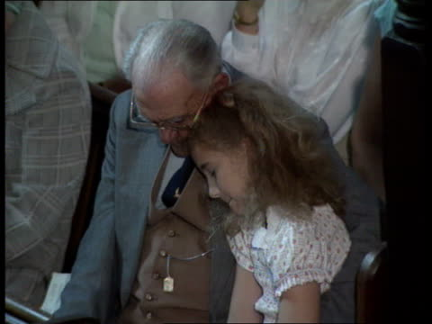 Duke of Edinburgh INT BV Congregation at memorial service MS Little girl comforted by old man MS Lady Mayor weeping in congregation MS Memorial card...