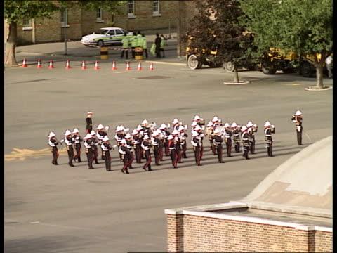 Marines parade ENGLAND Kent Deal Royal Marine Barracks TMS Marine Bandsmen marching on parade ground BV Policeman stopping traffic in street BV...