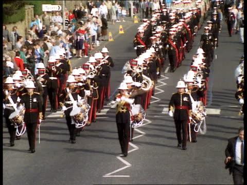 Marines parade TMS Royal Marines band along playing SOF