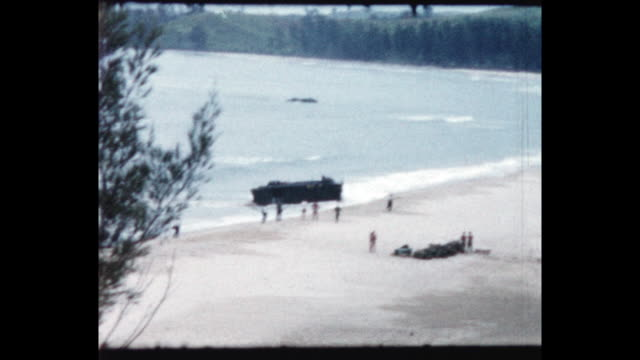 royal marines charge off landing craft onto the beach. from the home movie collection of jack dennis boles . boles spent 17 years in the colonial... - 英国海兵隊点の映像素材/bロール