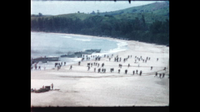 royal marines charge off landing craft onto the beach. from the home movie collection of jack dennis boles . boles spent 17 years in the colonial... - royal marines stock videos & royalty-free footage
