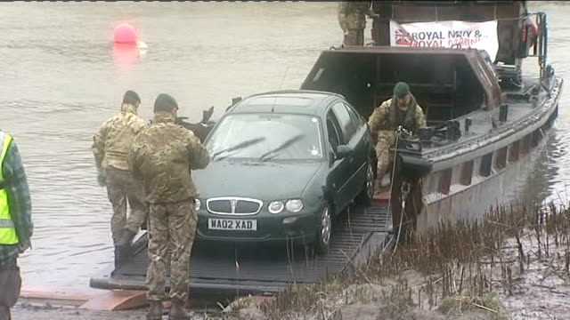 Royal Marines help rescue stranded cars following landslip in Cornwall ENGLAND Cornwall Calstock EXT Royal Navy boat along river Marines on boat...