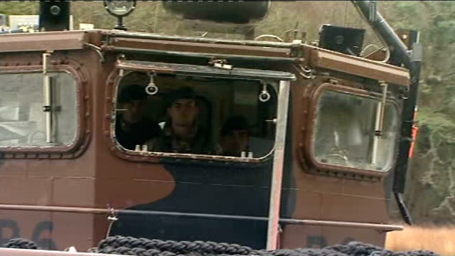 royal marines help rescue stranded cars following landslip in cornwall; flag flying on boat marine operating boat signalling to other marines at... - royal marines stock videos & royalty-free footage