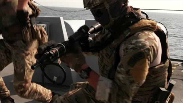 royal marines preparing weapons on board hms defender - warship stock videos & royalty-free footage