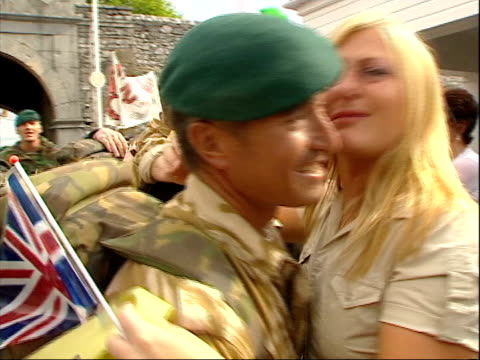 royal marines return home; lunchtime news: u'lay itn england: devon: plymouth: ext sequence returning members of the royal marines 42 commado unit... - 英国海兵隊点の映像素材/bロール