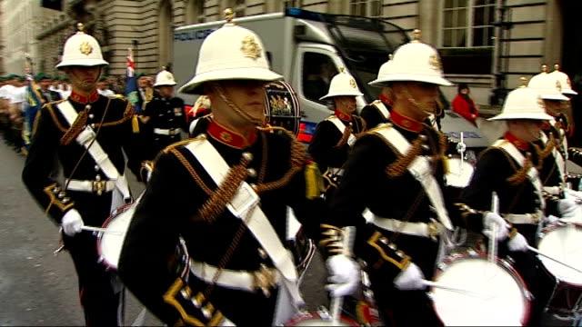 royal marines speed march marathon for charity; royal marines band along street members of commando 999 along behind the band - royal marines stock videos & royalty-free footage