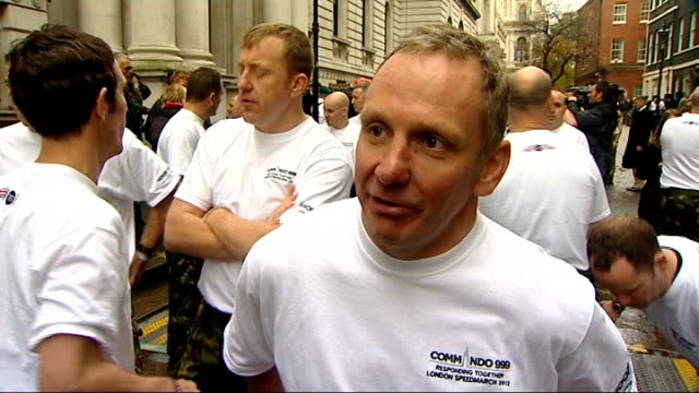 royal marines speed march marathon for charity royal marines being inspected by prime minister david cameron mp cameron speaking to marines sot... - world record stock videos and b-roll footage
