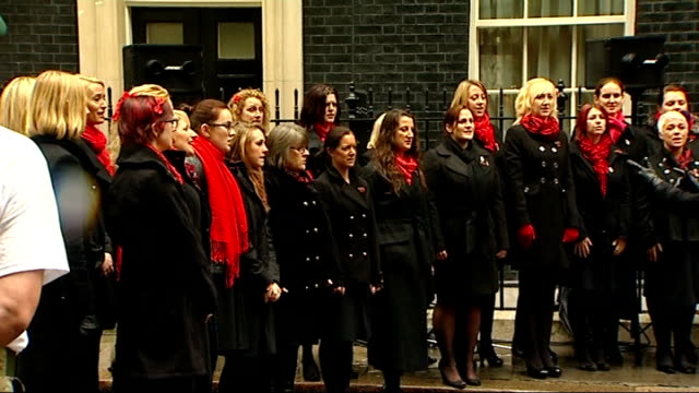 """royal marines speed march marathon for charity; the military wives choir singing """"jerusalem"""" cutaway cameron and stanhope listening - royal marines stock videos & royalty-free footage"""