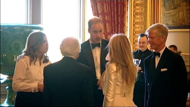 Royal Marsden Gala arrivals / Prince William speech Close shot Emili Sande in lineup / Prince William meeting Sande / William chatting with Ralph...
