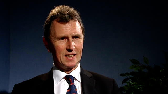 royal mint unveils new designs for british currency coins; london: int nigel evans mp interview sot - talks of losing britannia from coins - 王立鋳貨局点の映像素材/bロール