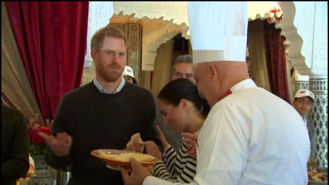 duke and duchess of sussex sample moroccan food at cooking school in rabat, meghan teases harry for taking a big bite - food and drink stock videos & royalty-free footage