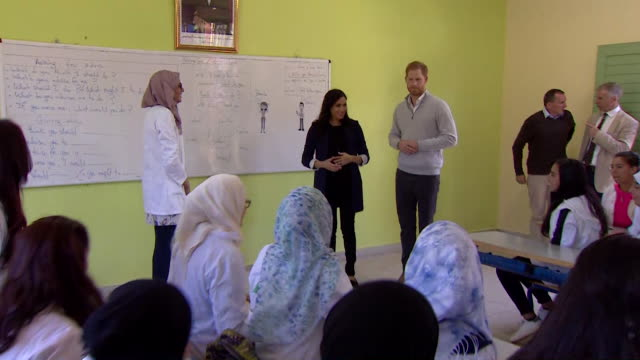duke and duchess of sussex visit classroom in rabat at education for all boarding house meghan jokes it's a long time since we've been in a classroom - meghan duchess of sussex stock videos and b-roll footage