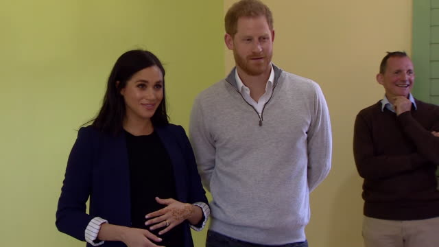 duke and duchess of sussex visit classroom in rabat close up of meghan cradling her bump with henna on her hands - meghan duchess of sussex stock videos and b-roll footage