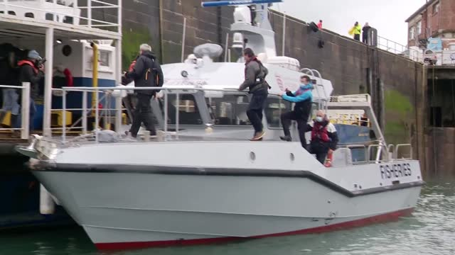 royal navy and french navy vessels patrol as french fishermen blockade harbour in fishing dispute; jersey, saint helier; blockade of st helier port... - channel islands england stock videos & royalty-free footage