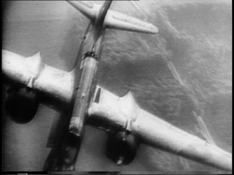 royal navy forces land in dieppe france / ships at dawn firing / barges approaching shore / american airplanes warming up in darkness and taking off... - flugabwehr stock-videos und b-roll-filmmaterial