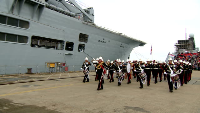 hms illustrious aircraft carrier decommissioned england hampshire portsmouth ext military band march along past docked hms illustious at hms... - hampshire england stock videos and b-roll footage