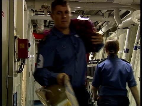 vídeos de stock, filmes e b-roll de hms illustrious crew along corridor including carrying boxes of food provisions - característica de construção