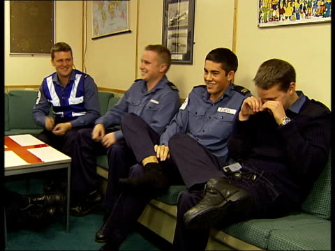 illustrious; crew members chatting and laughing in recreation room sot - discuss 'eastenders' television programme more of crew playing cards and... - eastenders stock videos & royalty-free footage