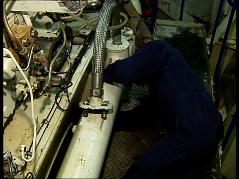 hms illustrious general views of control room with clocks dials control panels and male crew members at work including one with calculator / general... - rolls royce stock videos & royalty-free footage