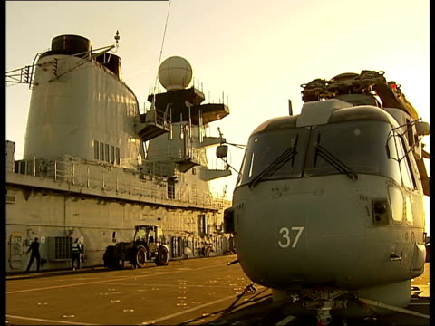 HMS Illustrious Helicopter landing strip / Low angle views of rotors turning