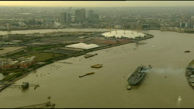 hms illustrious in london for remembrance day events tx illustrious passing through thames barrier and sailing into greenwich english channel on... - sea channel stock videos and b-roll footage
