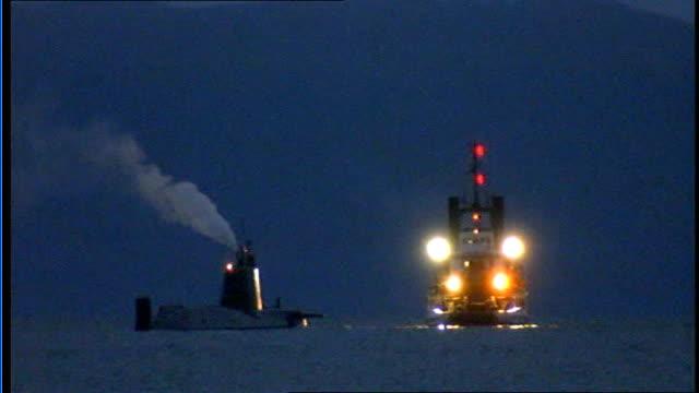 royal navy nuclear submarine runs aground off scotland scotland isle of skye astute with tug next - ヘブリディーズ点の映像素材/bロール