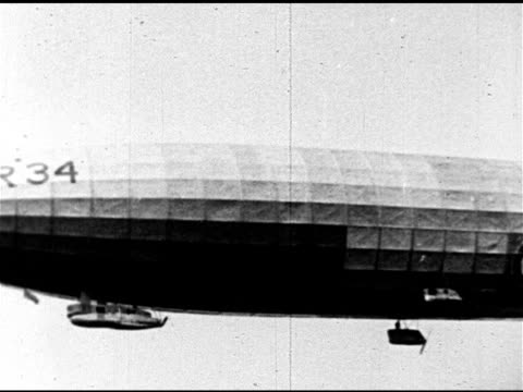 royal navy r34 class rigid airship in flight ms r34 in flight w/ call numbers near front of aircraft r34 landing in field - airship stock videos & royalty-free footage