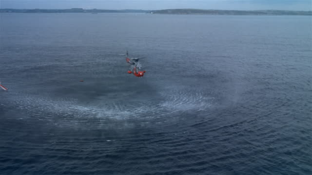 stockvideo's en b-roll-footage met air to air, royal navy rescue helicopter flying above sea, france  - red sea