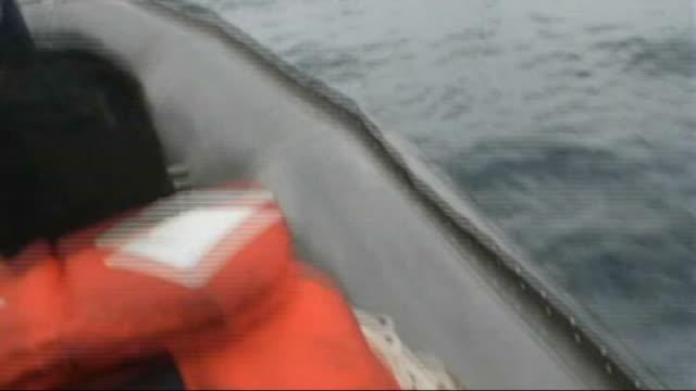 royal navy resumes patrols of arabian gulf; at sea: northern arabian gulf: ext shot as along at sea aboard royal navy patrol boat reporter to camera... - ペルシャ湾点の映像素材/bロール