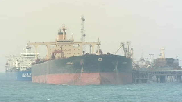 stockvideo's en b-roll-footage met royal navy resumes patrols of arabian gulf; ext on board patrol boat shot from rn patrol boat as approaching offshore oil platform ext oil tanker... - perzische golf