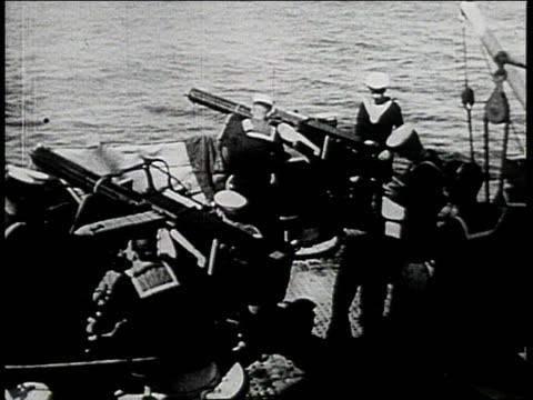 royal navy sailors firing pom poms and machine guns from ship during wwii - pom pom stock videos & royalty-free footage